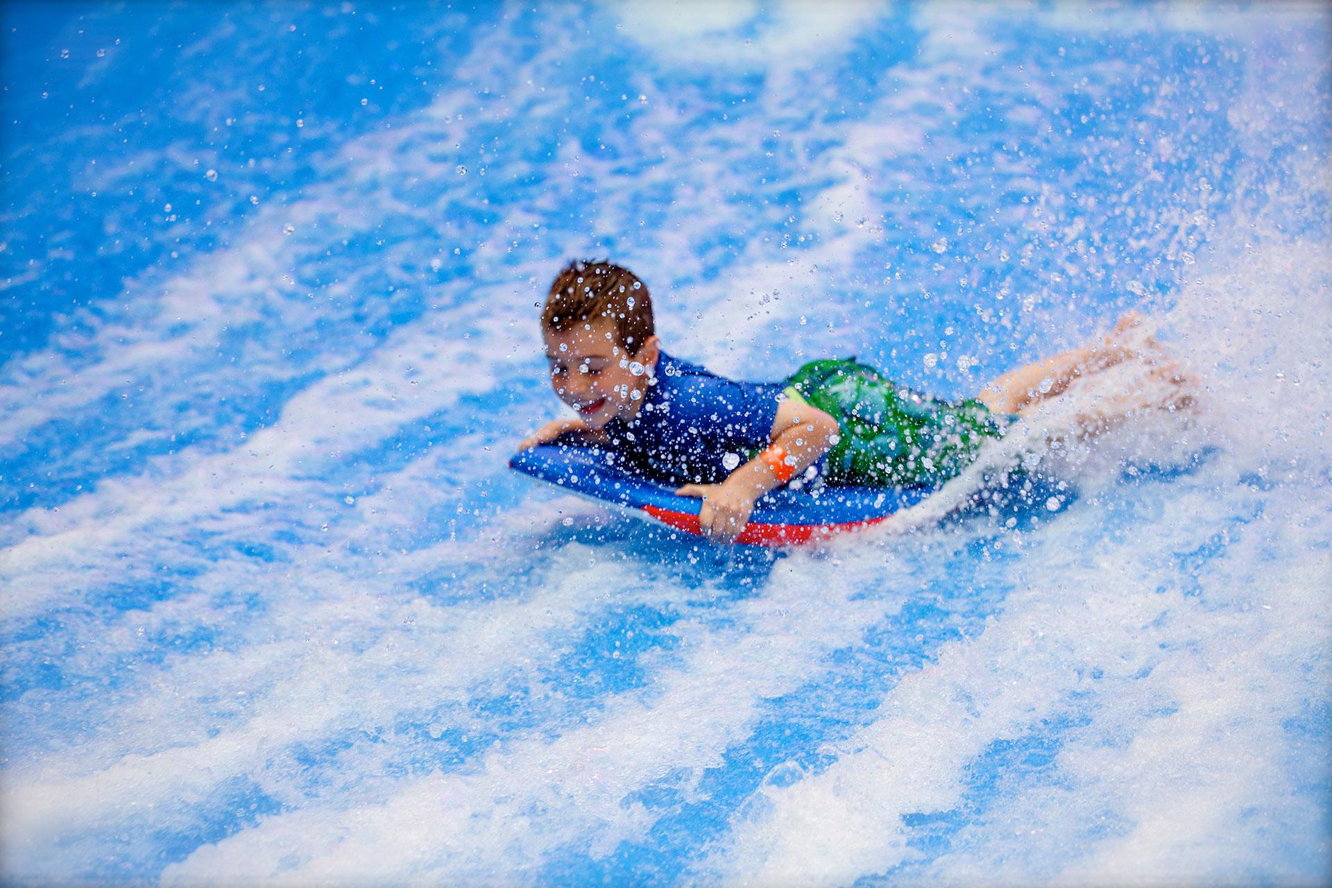 Boy on FlowRider at Camelback Resort & Indoor Waterpark; Courtesy of Camelback Resort & Indoor Waterpark