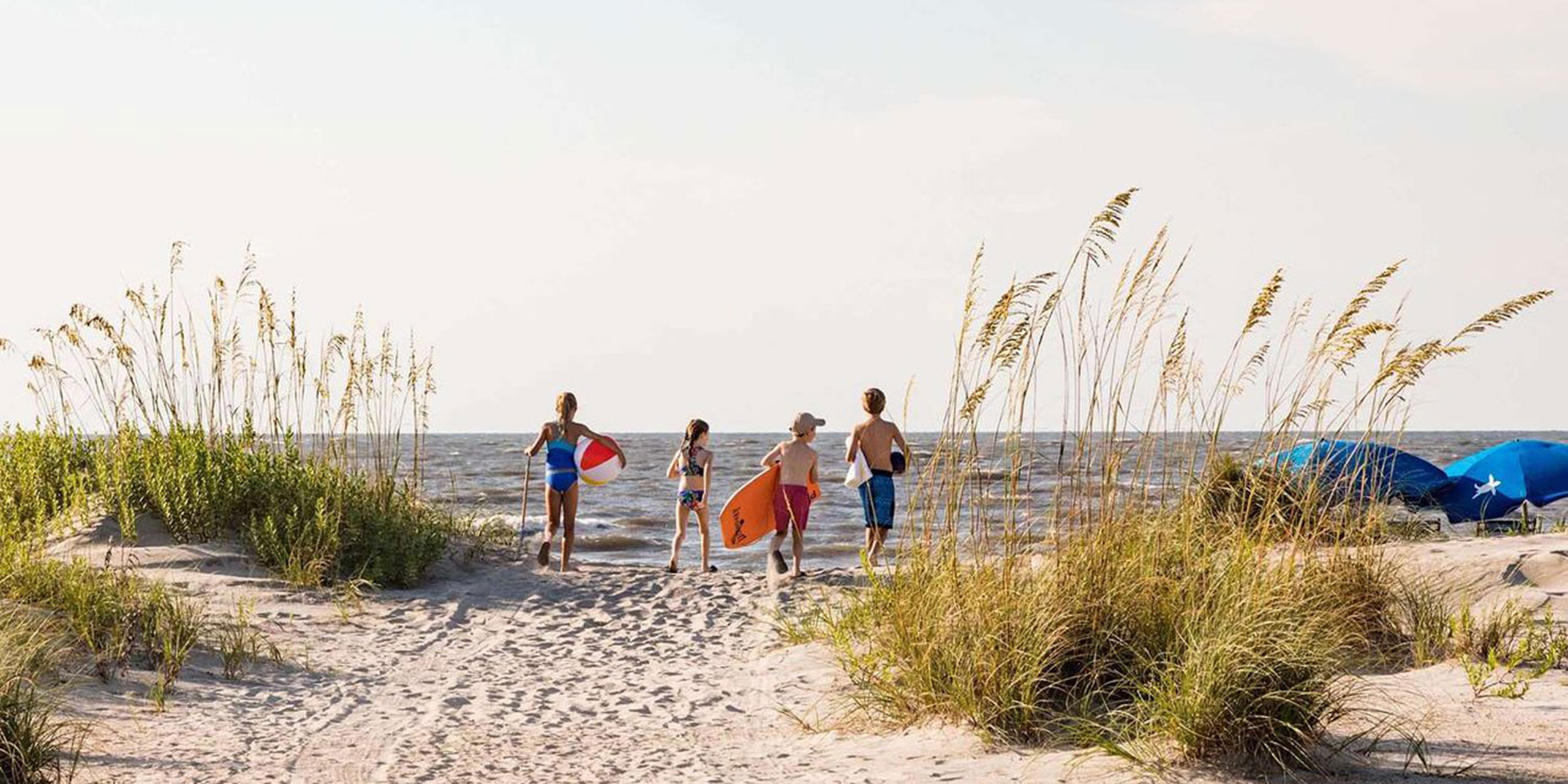 Family on Beach at Wild Dunes Resort in South Carolina