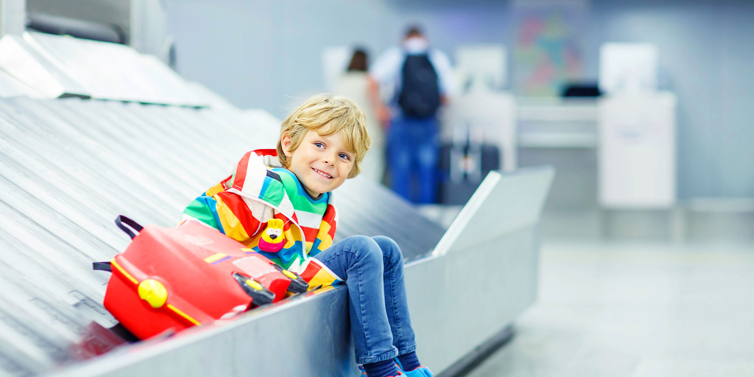 Kid at Airport Baggage Claim; Courtesy of Romrodphoto/Shutterstock.com