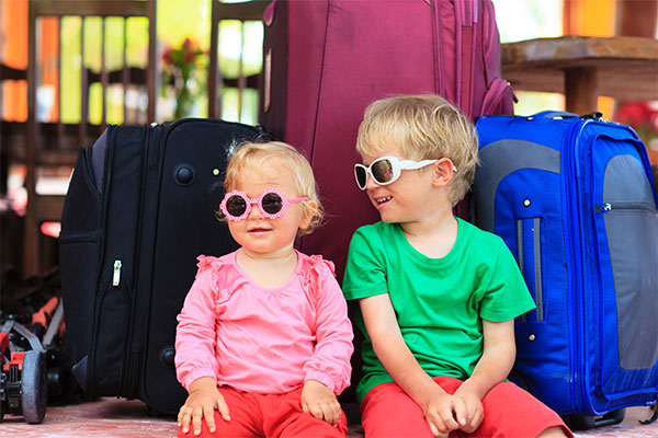 Toddlers at Airport Wearing Sunglasses