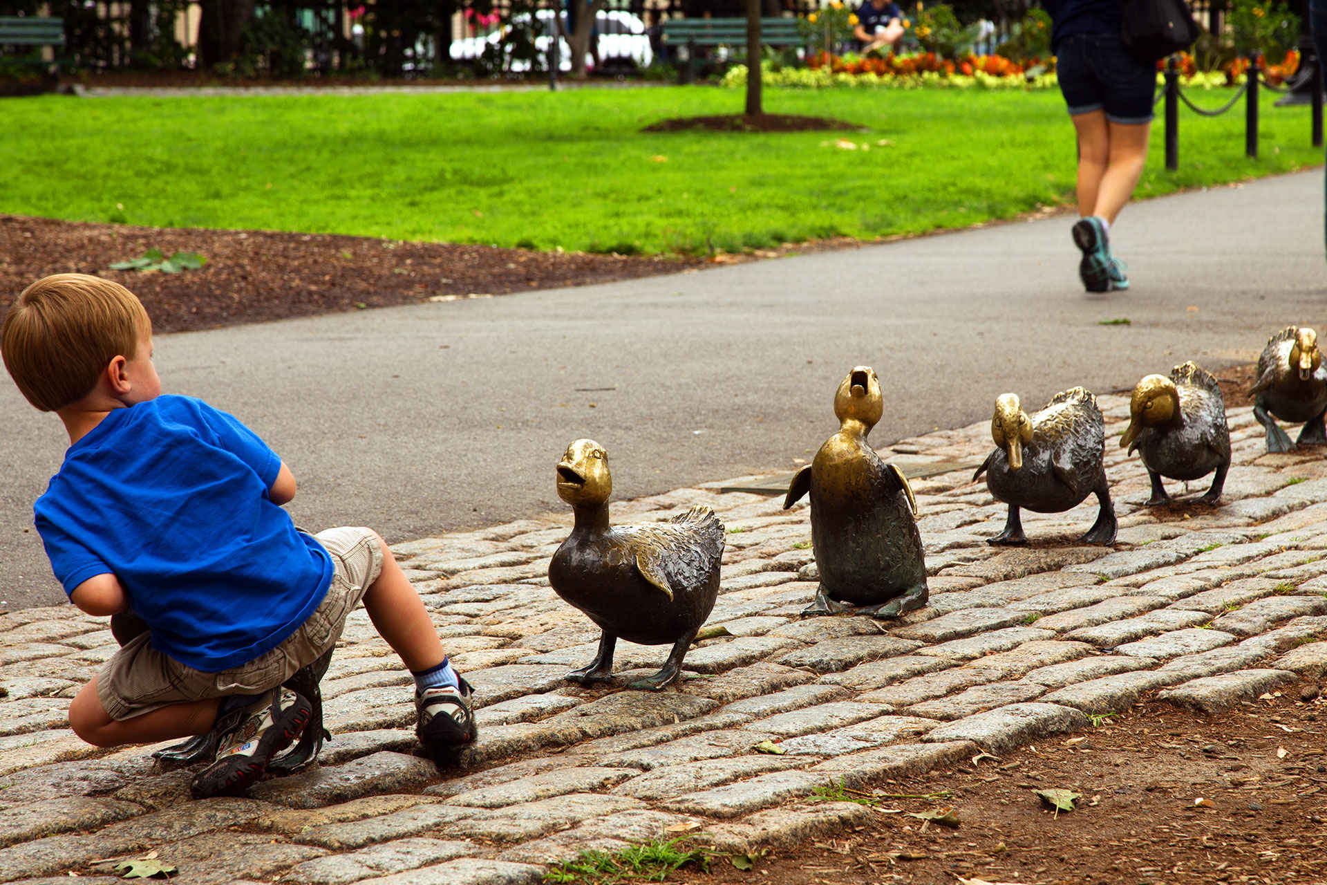 Little Boy Playing With Boston Ducks; Courtesy of Greater Boston Convention & Visitors Bureau