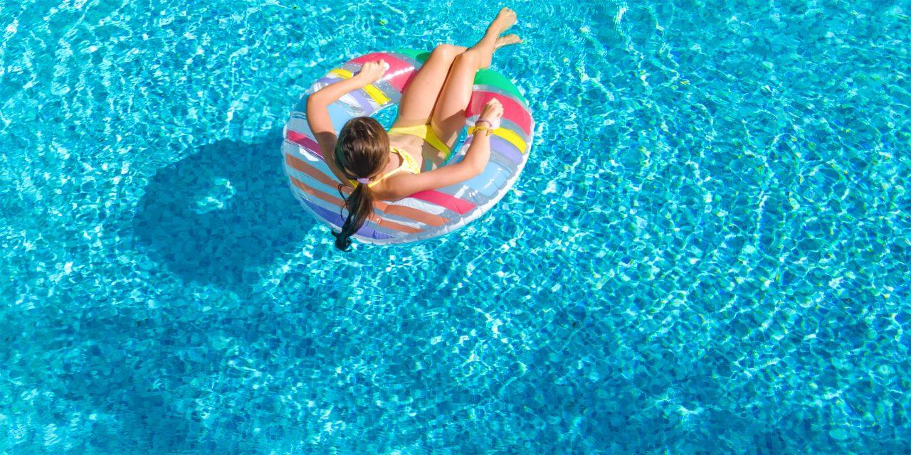 Girl in Hotel Pool; Courtesy of JaySi/Shutterstock.com