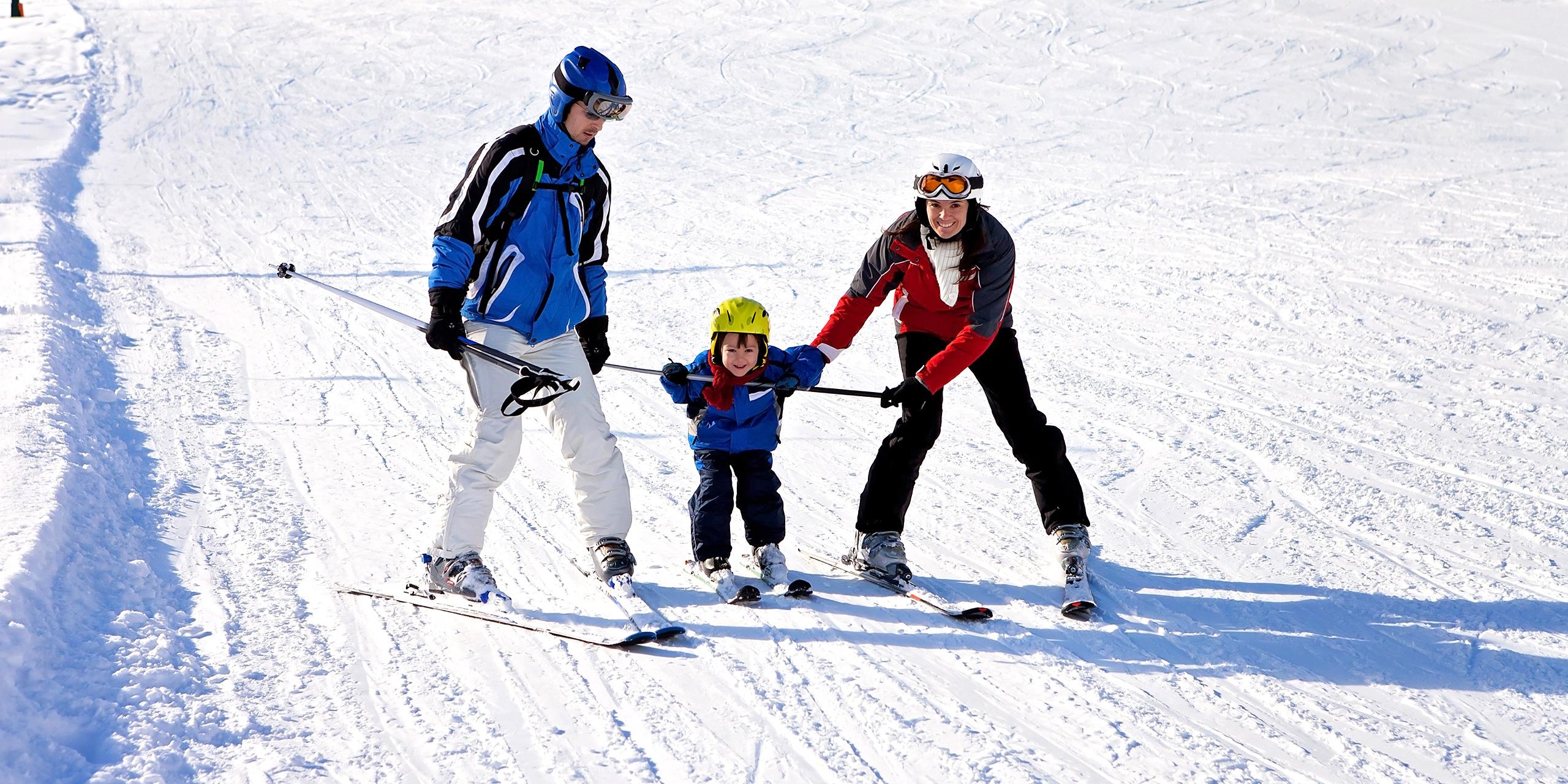 Family learning ski; Courtesy of Tomsickova Tatyana /Shutterstock