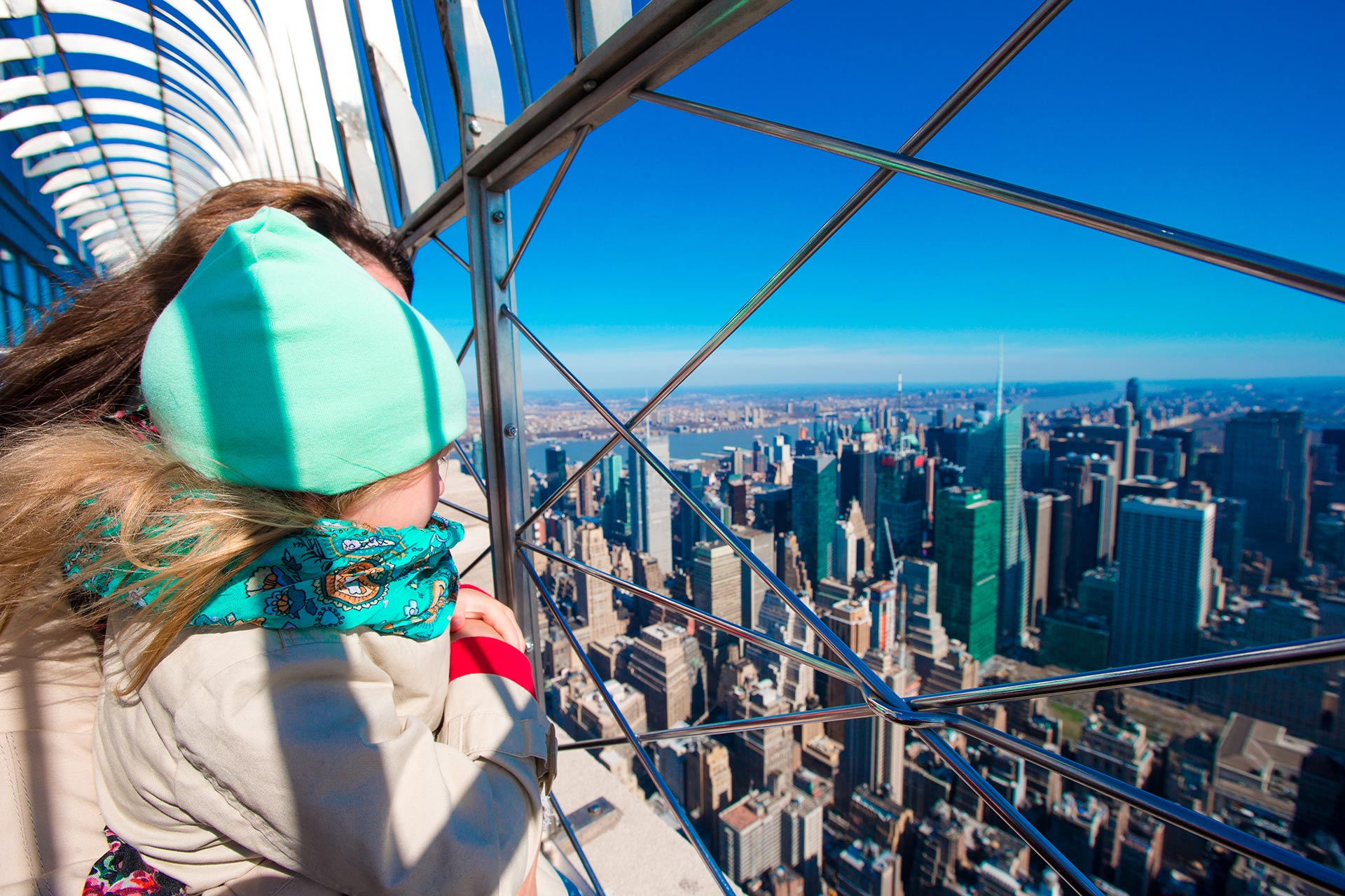 A little girl checking out the view of New York City from the Empire State Building.