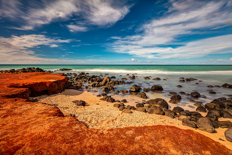 Maui Red Dirt at Baby Beach On the North shore of Maui, Hawaii; Courtesy of Pierre Leclerc/Shutterstock