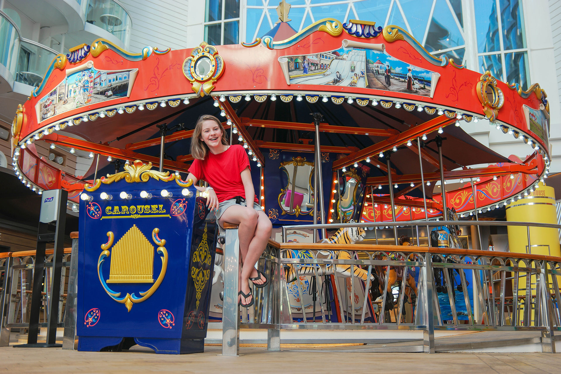 Teen Girl In Front Of Carousel On Royal Caribbeans Symphony The Seas Courtesy