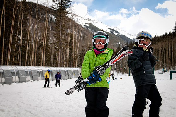 Two kids getting ready to hit the slopes at Taos Ski Valley in New Mexico.; Courtesy of Thatcher Dorn/Taos Ski Valley