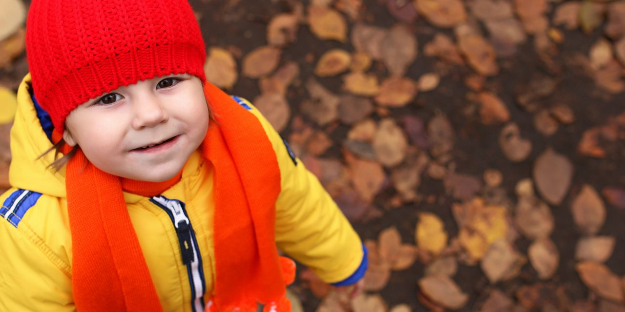 Little Boy Playing in the Fall Leaves; Courtesy of alexkich/Shutterstock.com
