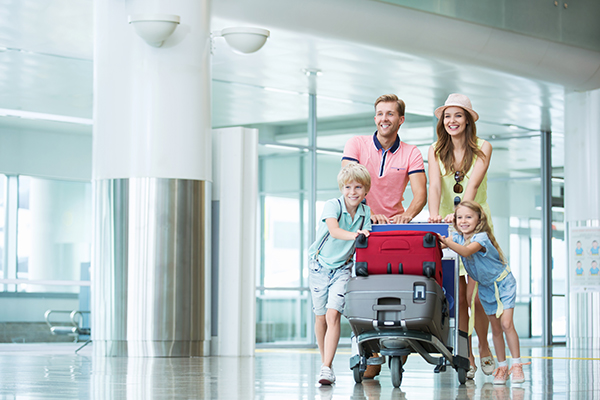 A family of four traveling through the airport