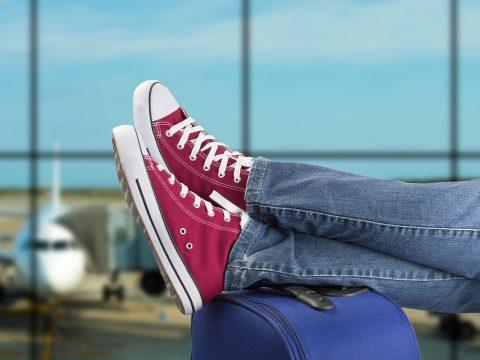 Teenager's Sneakers on Suitcase at Airport; Courtesy of cunaplus/Shutterstock.com