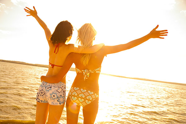 Two Young Girls on Beach at Sunset