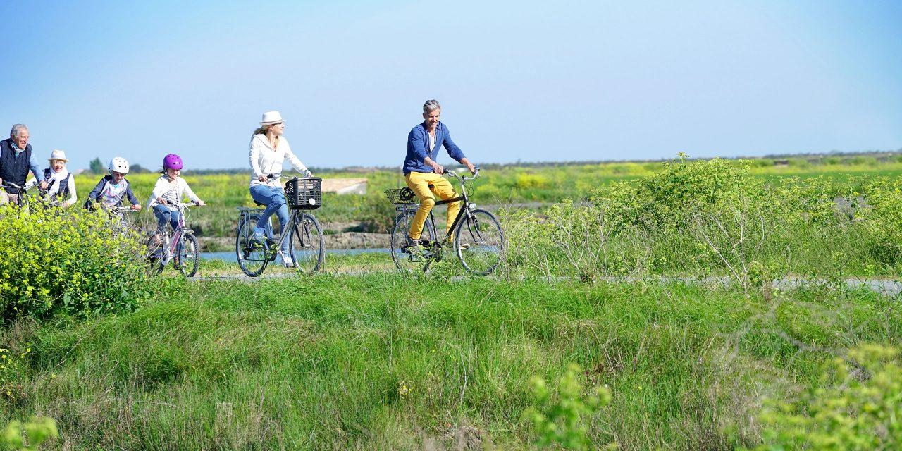 Multigenerational Family Biking; Courtesy of goodluz/Shutterstock.com