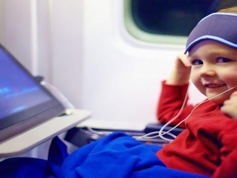 Kid On Plane; Courtesy of Olesia Bilkei/Shutterstock.com