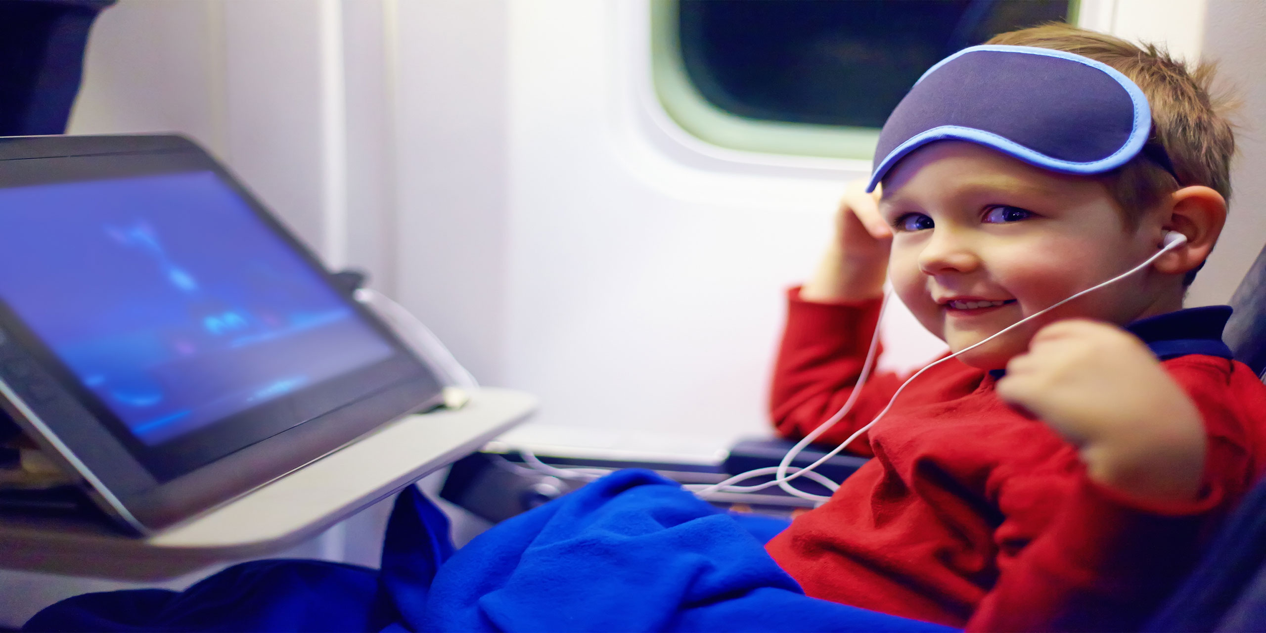 Kid On Plane; Courtesy of Olesia Bilkei/Shutterstock.com