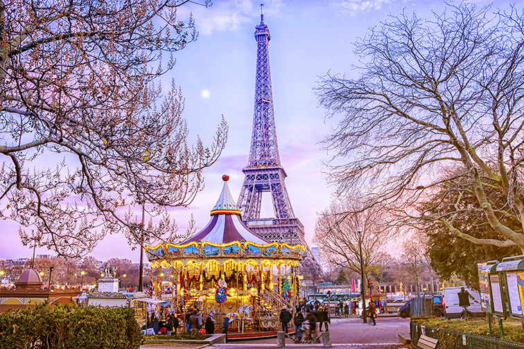 The Eiffel Tower and vintage carousel on a winter evening in Paris; Courtesy of MarinaD_37/Shutterstock