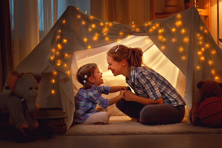 mother and daughter playing at home in a tent;Courtesy of Evgeny Atamanenko/Shutterstock