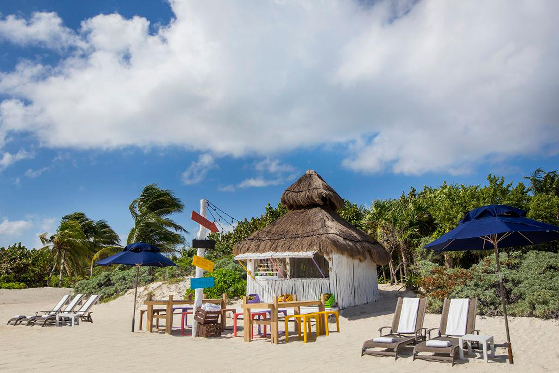 Banyan Tre Mayakoba, hut on the beach with umbrellas and beach chairs