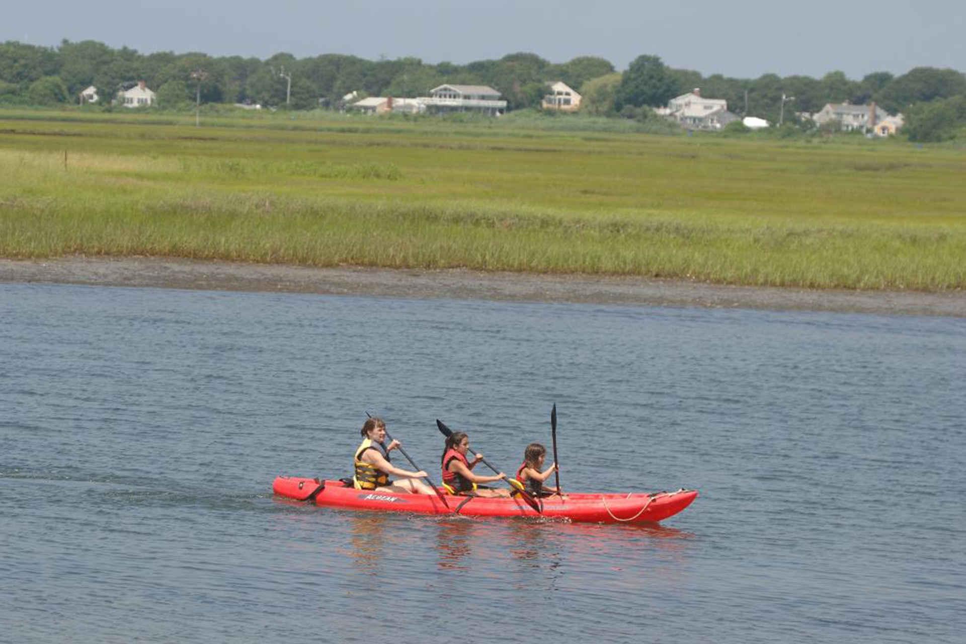 Red Jacket Beach Resort and Spa, 3 people on red kayak