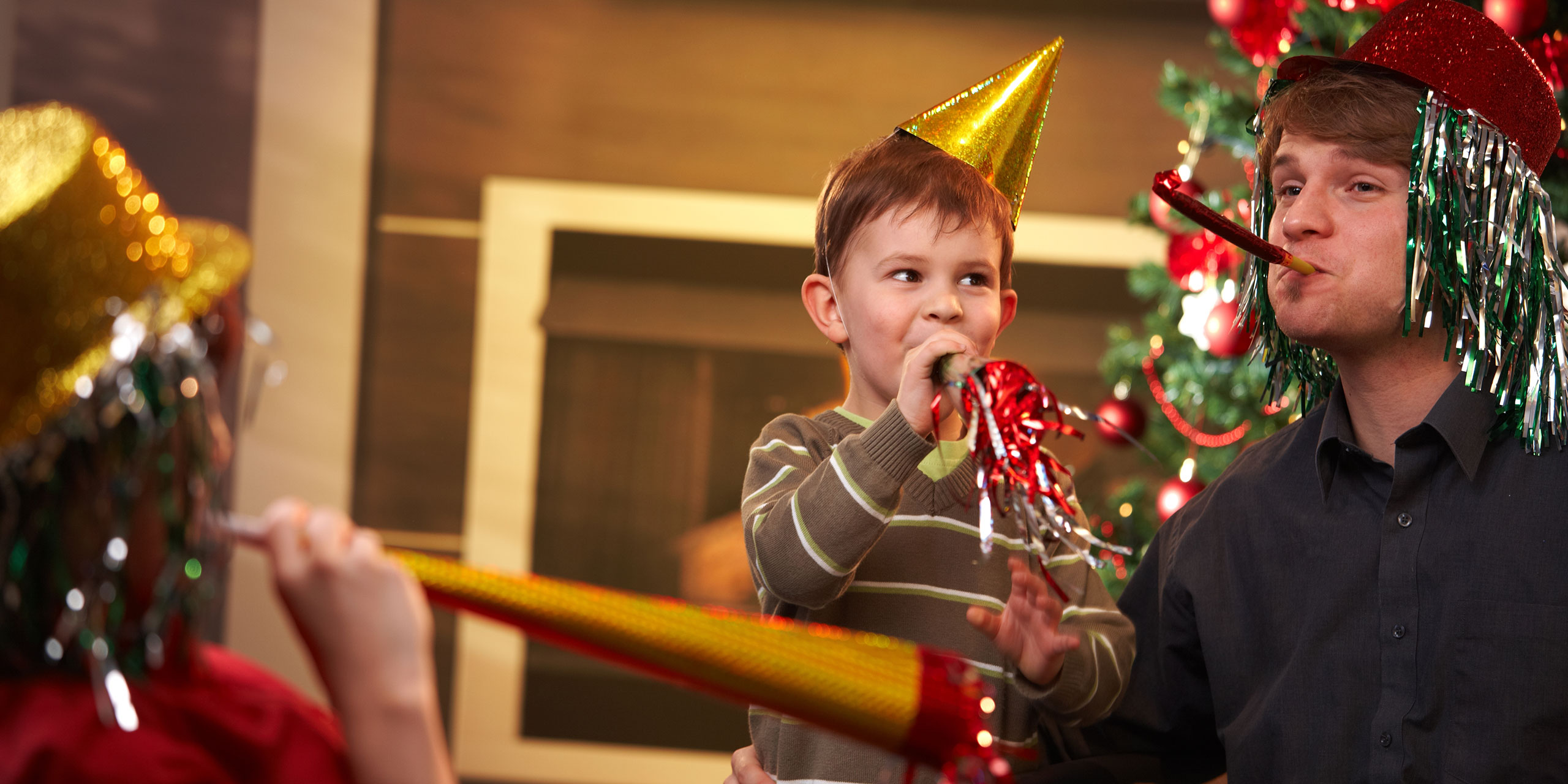 Family Celebrating New Year's Eve; Courtesy of StockLite/Shutterstock.com