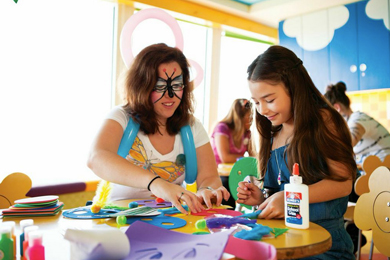 Young Girl Plays with Arts and Crafts on Norwegian Cruise Line