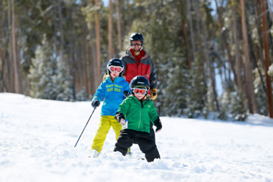 A family making some serious turns down the mountain at Granby Ranch in Colorado.