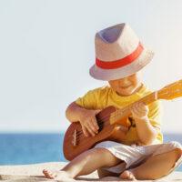Little Boy Playing Ukulele in Hawaii; Dmitry Molchanov/Shutterstock.com