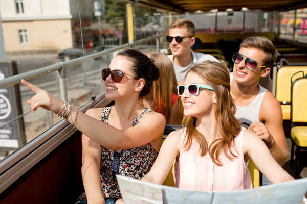 Teens traveling around on a tour bus.