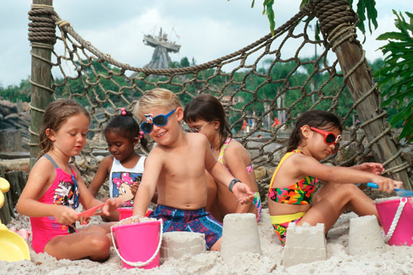 Kids playing in the sand at Walt Disney World in Florida.