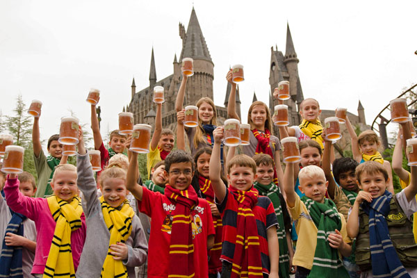 A group of kids drinking butterbeer at The Wizarding World of Harry Potter in Orlando, Florida.