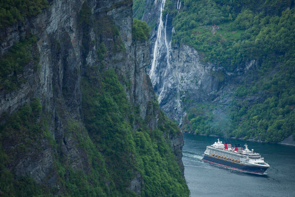 Disney Magic makes its way through the cliffs of Norway.
