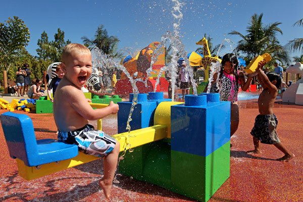 A little boy playing at the LEGOLAND California Water Park.