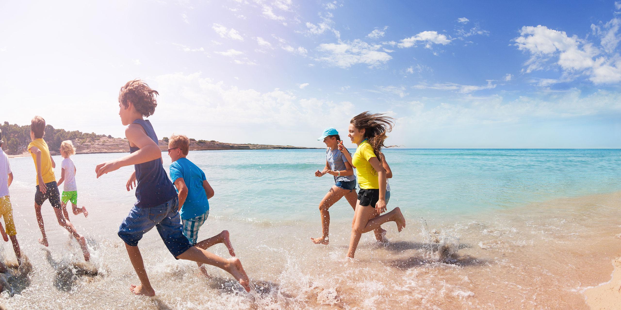 Teens and Tweens Running on Beach; Courtesy of Sergey Novikov/Shutterstock.com