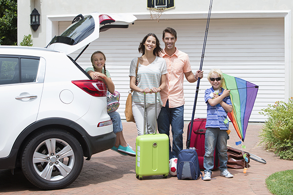 A family packing up their car to head to their vacation rental.