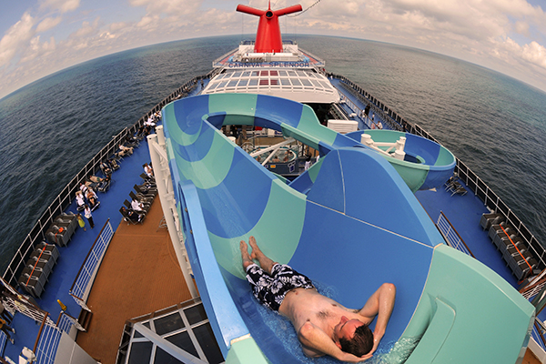 A man going down one of the waterslides on board Carnival Splendor.
