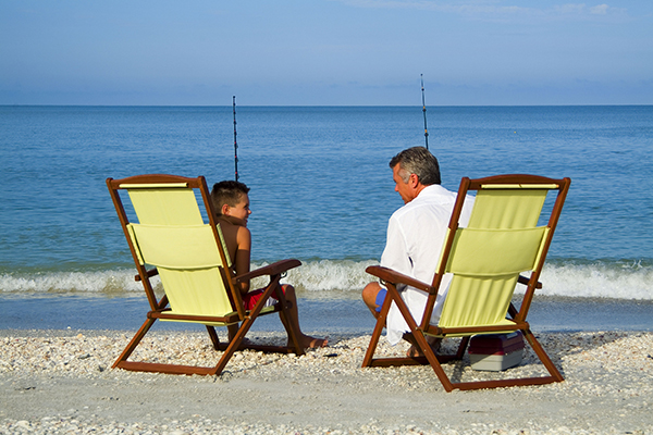 Father and son fishing along Captiva Beach.