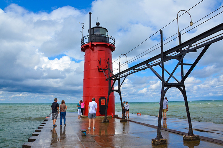 Visitors admire the South Haven lighthouse, at South Haven beach on Lake Michigan; Courtesy of Susan Montgomery/Shutterstock