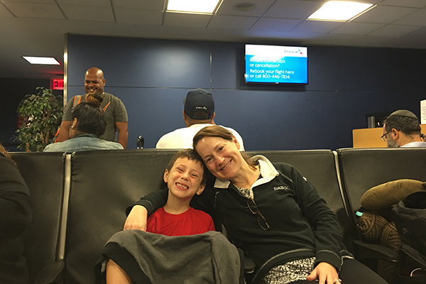 Mother and son waiting to board a plane at the airport.