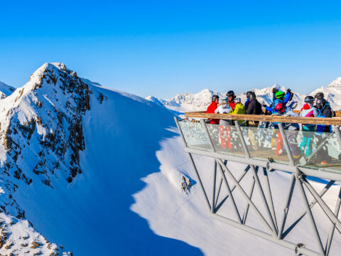 Skiers looking at mountains from platform in Solden ski ; Courtesy of Pawel Kazmierczak/Shutterstock
