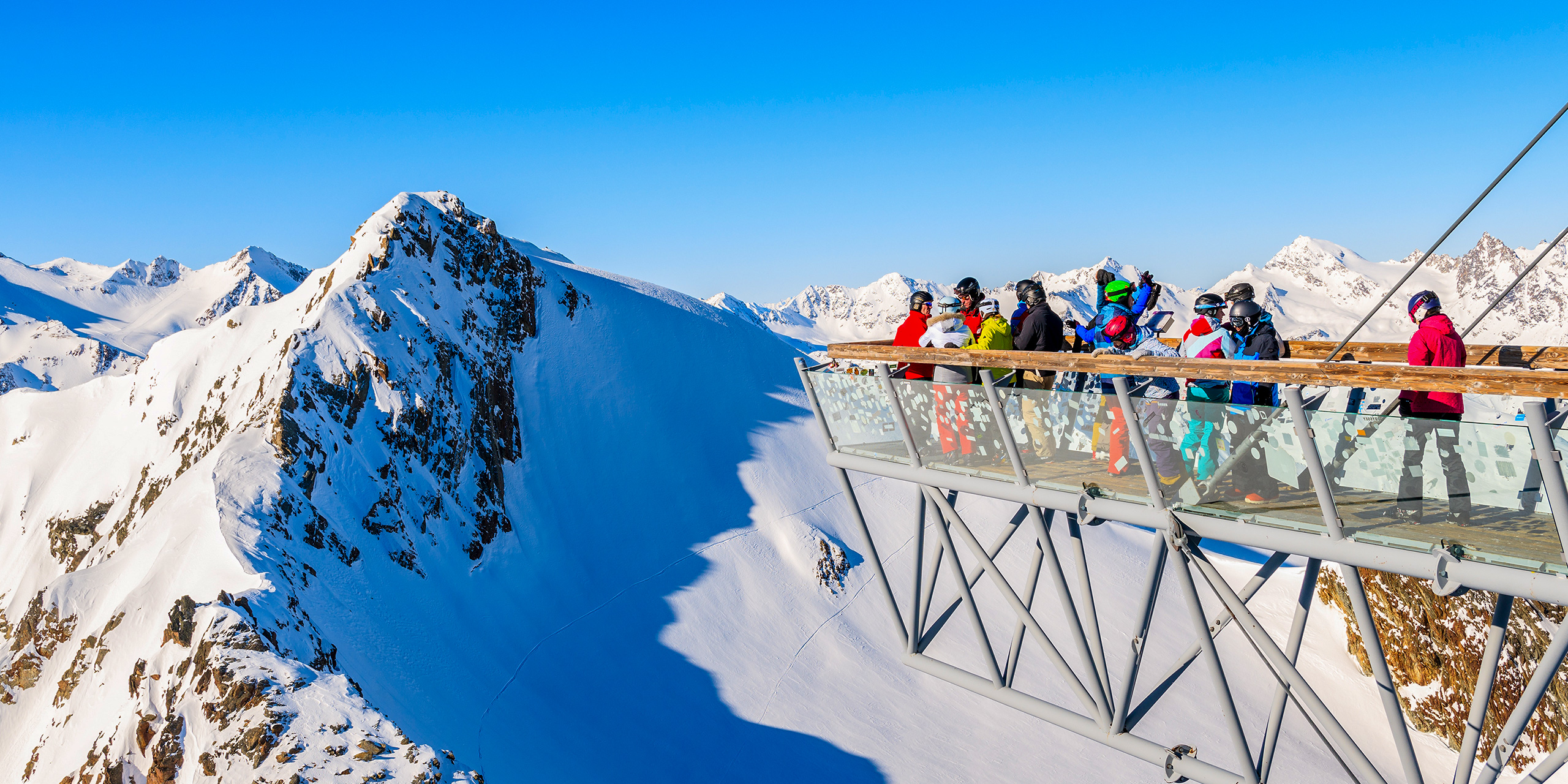 Skiers looking at mountains from platform in Solden ski ; Courtesy of Pawel Kazmierczak/Shutterstock