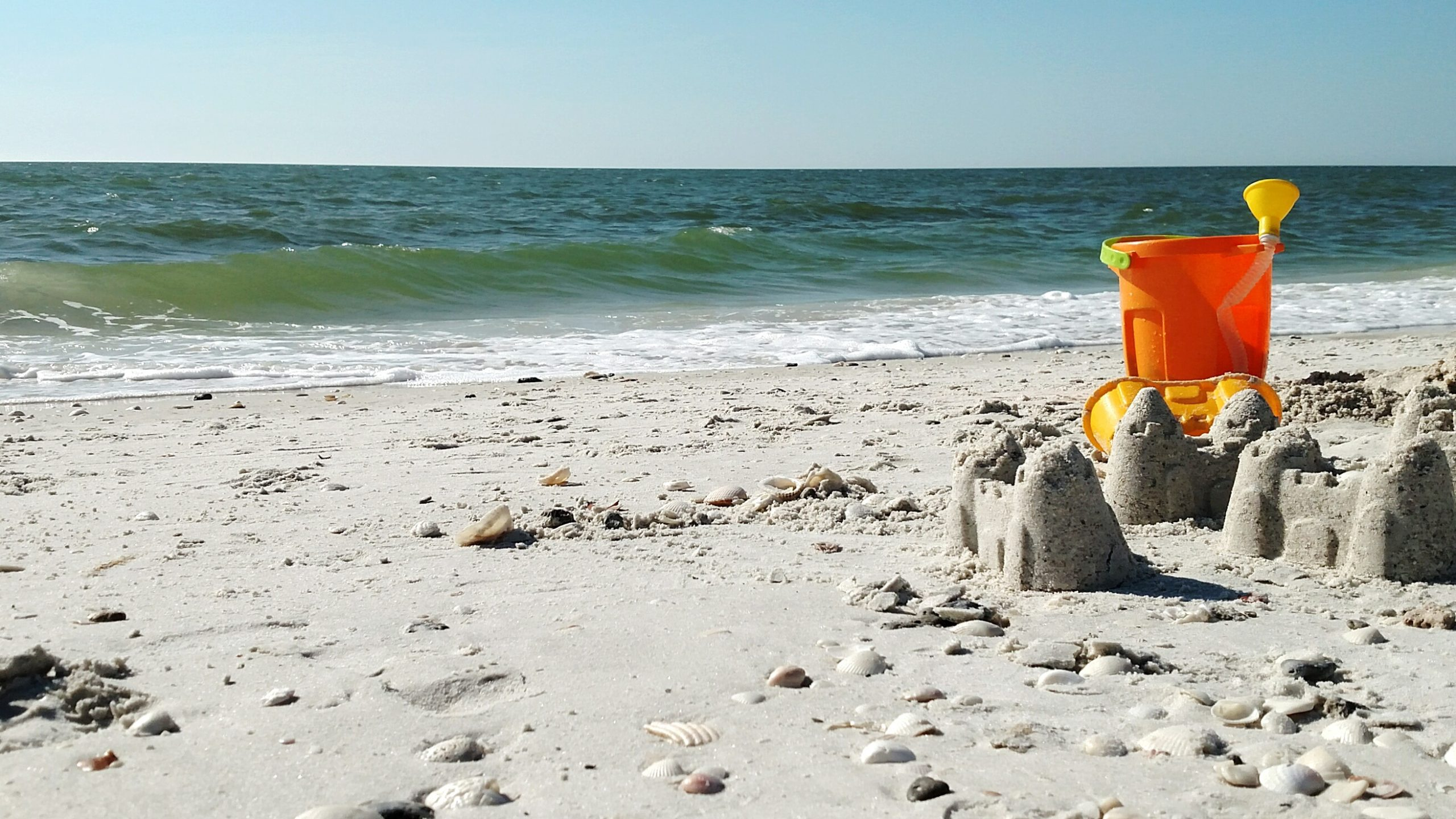 Sandcastles and sand toys on the beach
