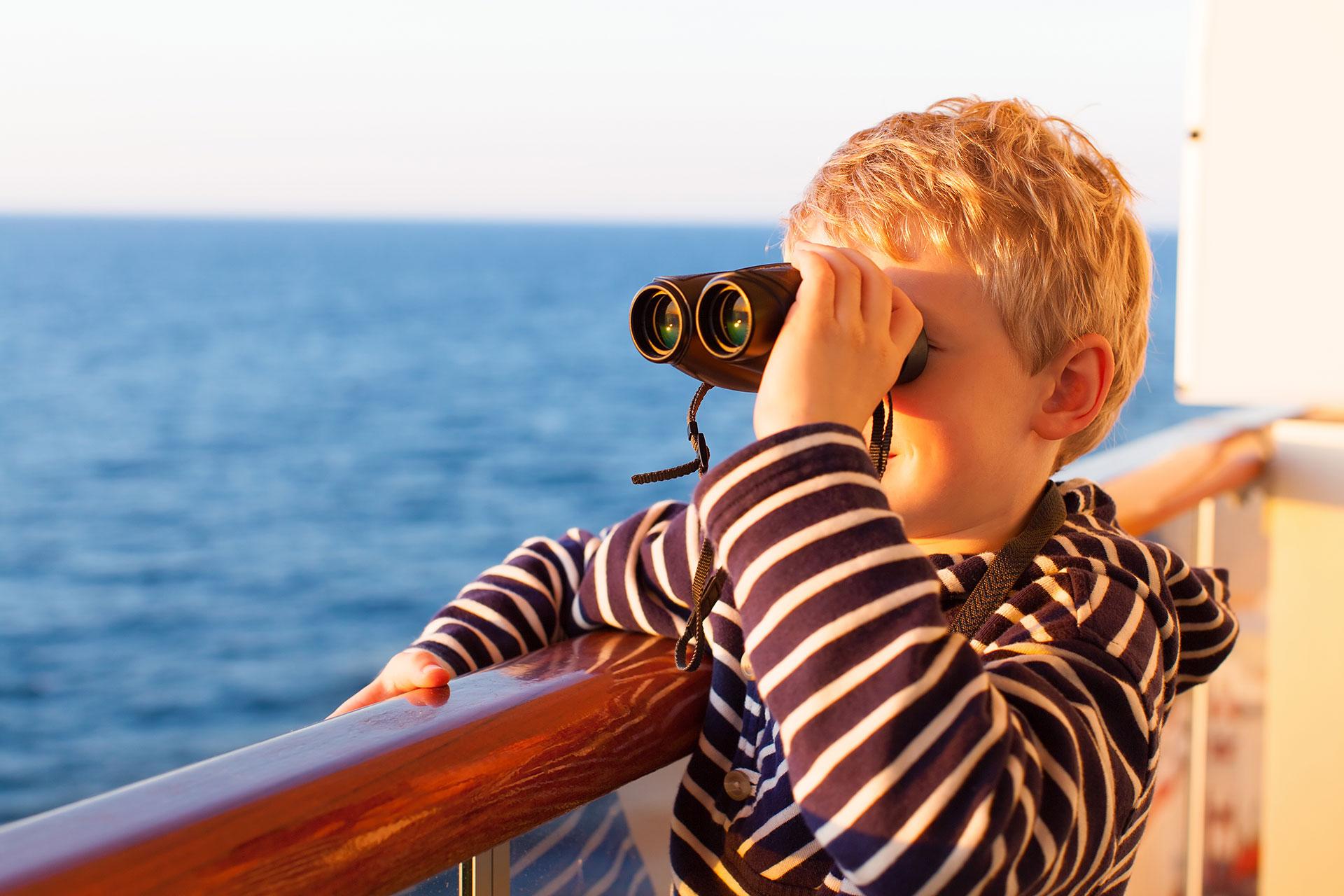 Young Boy With Binoculars on Cruise