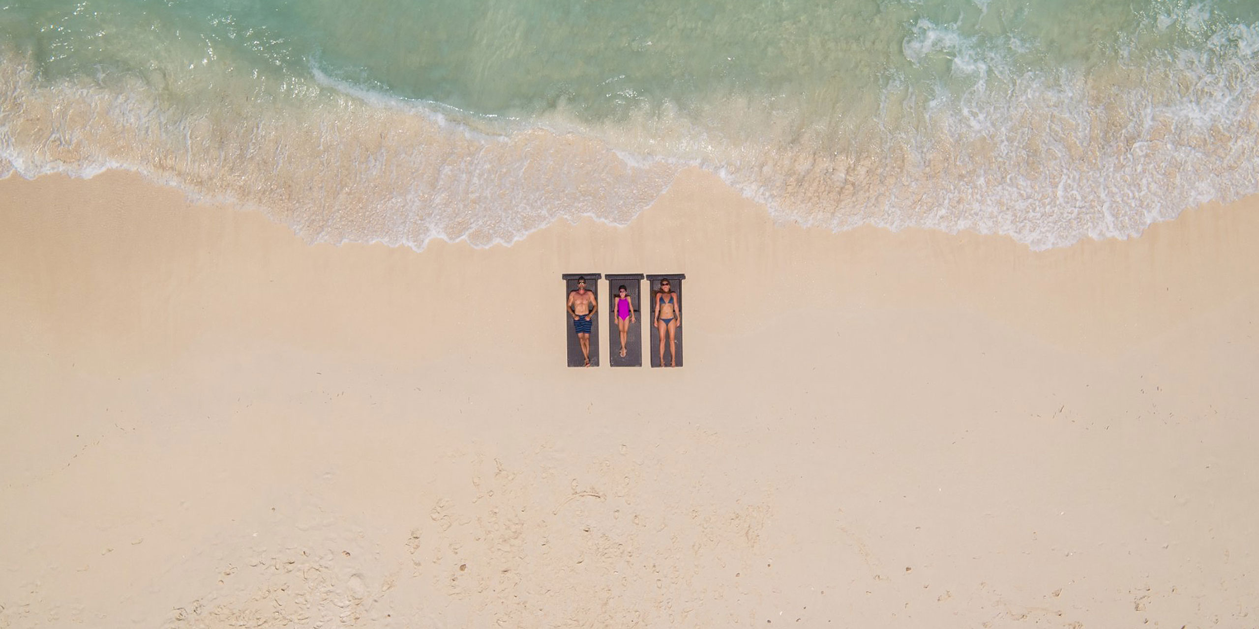 Aerial View of Family on Beach at Resorts World Bimini; Courtesy of Resorts World Bimini