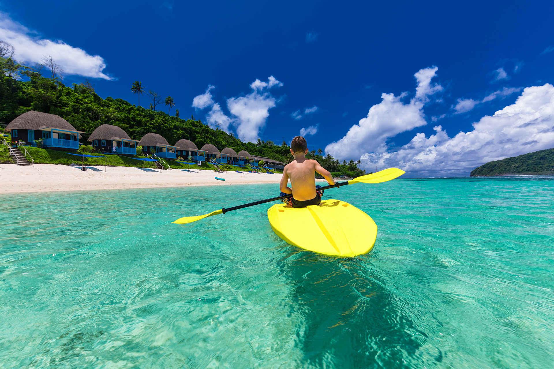 Boy Paddleboards in Fiji
