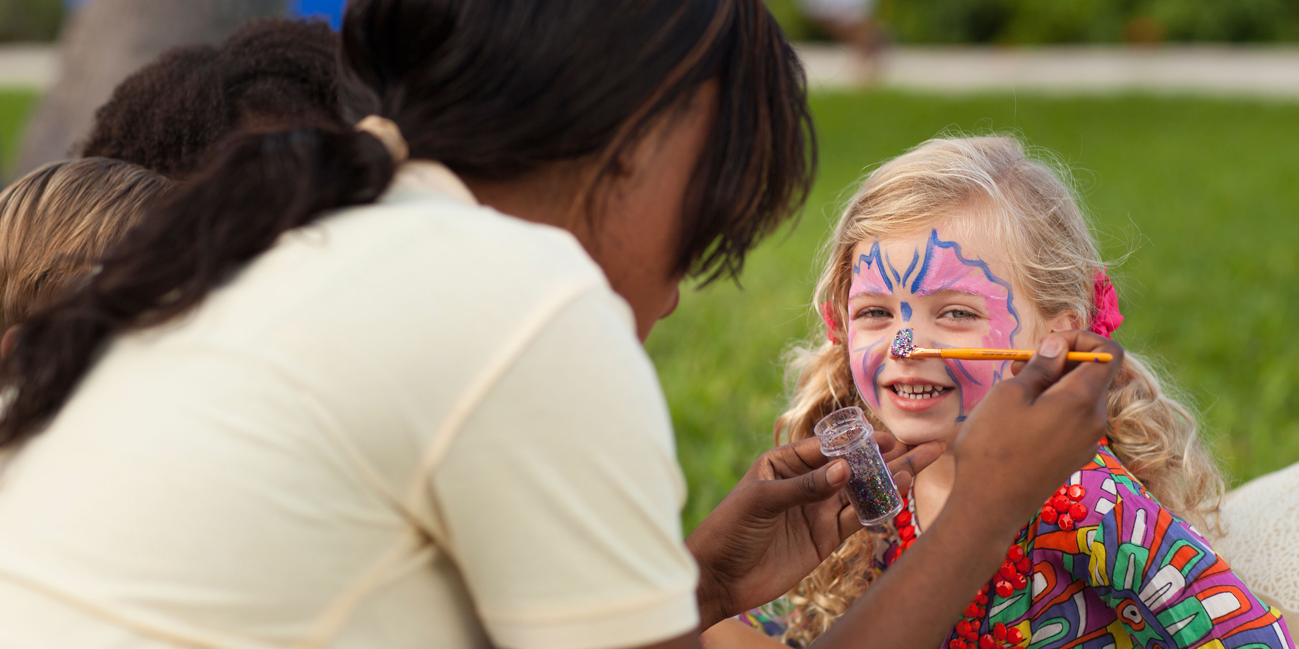 Nanny Painting Young Girl's Face at Beaches Resorts; Courtesy of Beaches Resorts