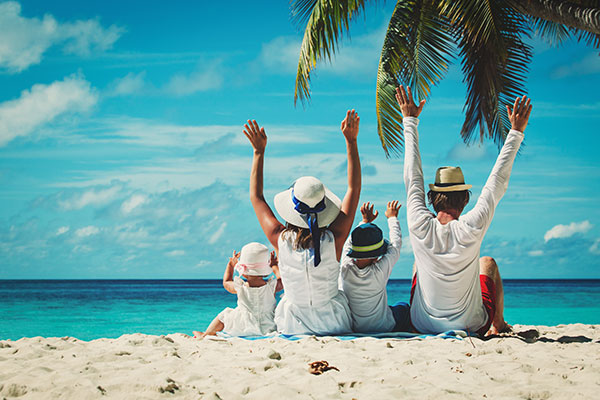 A family enjoying their beach vacation.