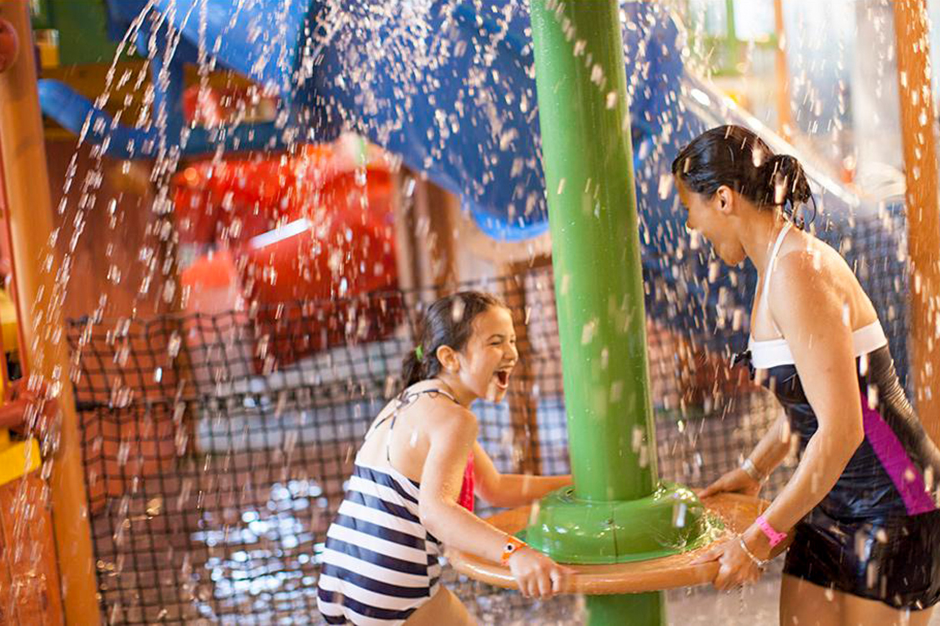 mom plays at waterpark with daughter; Courtesy of Great Wolf Lodge Wisconsin Dells