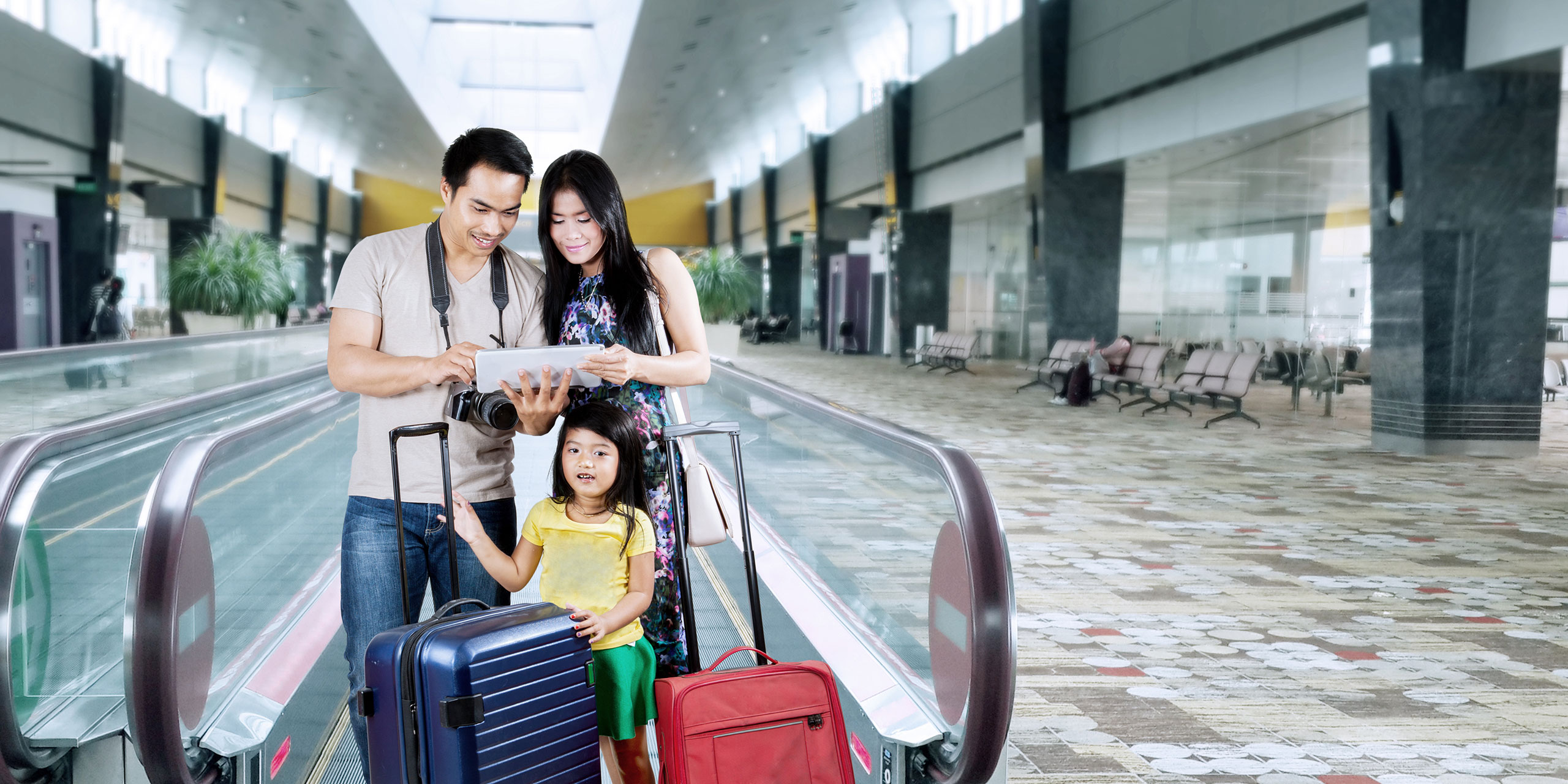 Asian Family at Airport: Courtesy of Creativa Images/Shutterstock.com