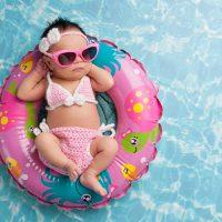 Infant Floating in Pool Wearing Sunglasses; Courtesy of Katrina Elena/Shutterstock.com