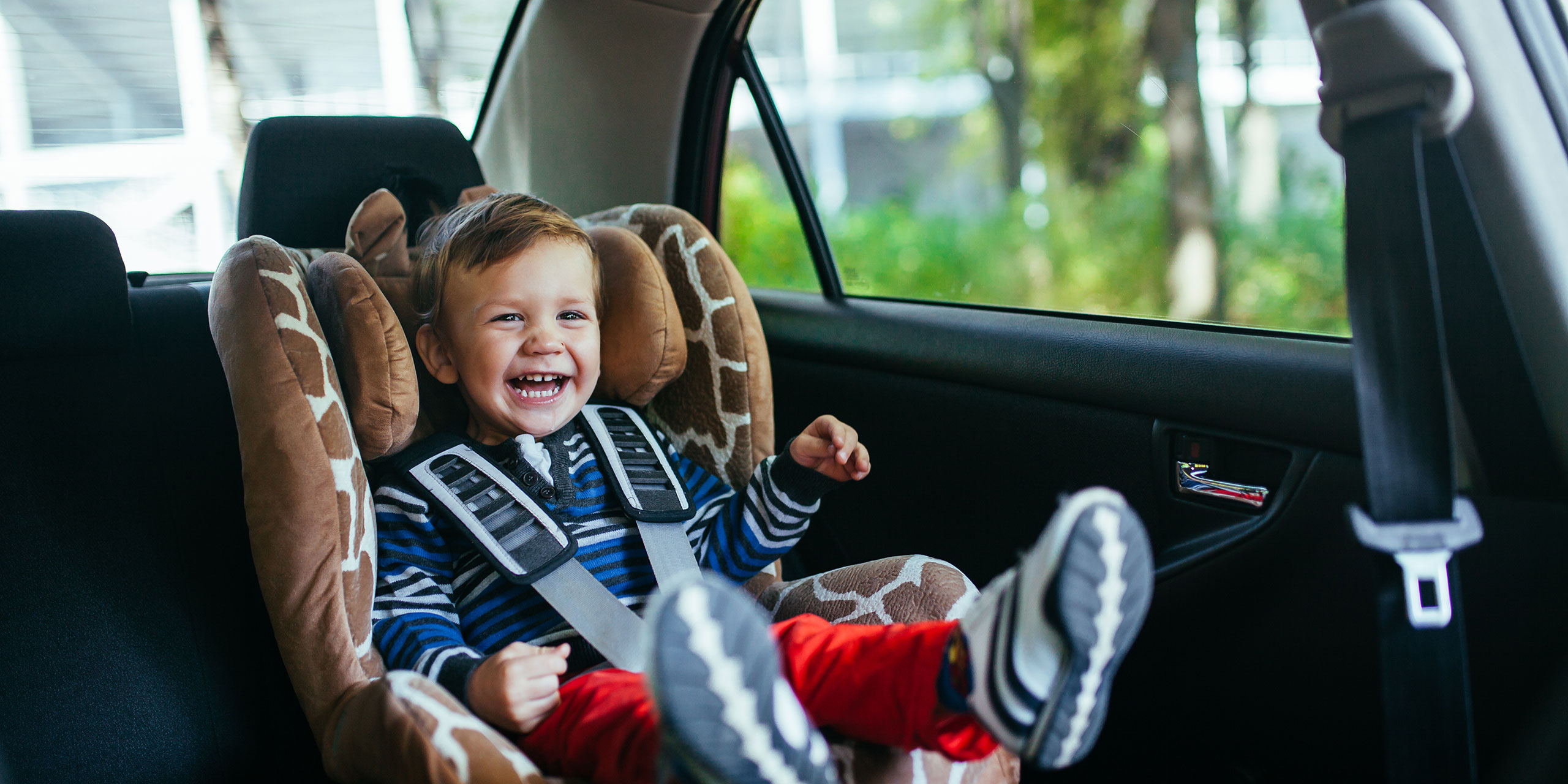 Toddler in Car Seat; Courtesy of David Tadevosian/Shutterstock.com