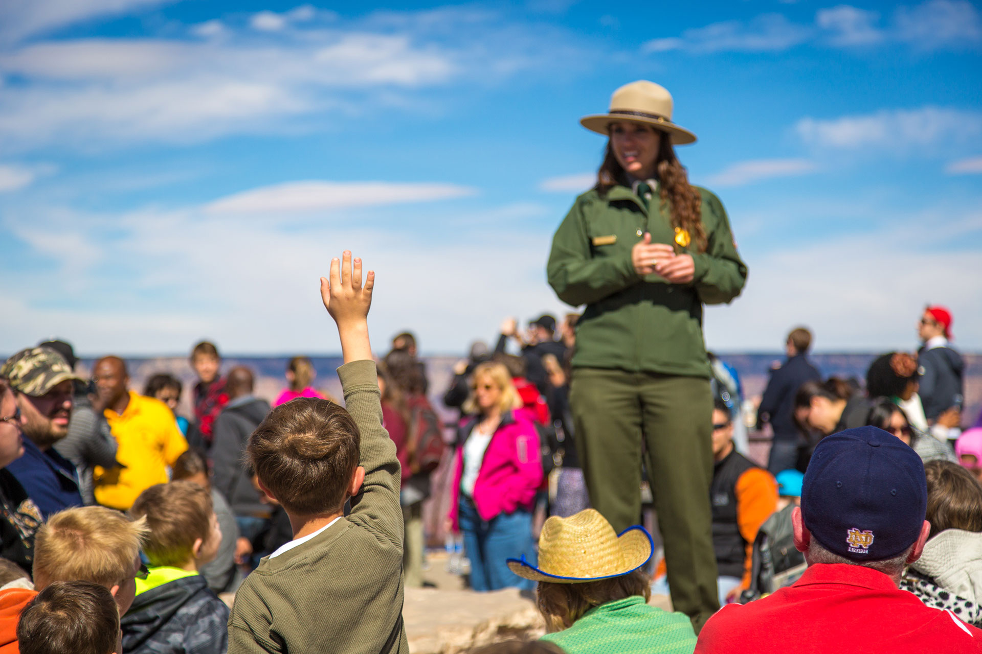 A park ranger replying to a kid's question in the south rim of Grand Canyon National Park, Arizona